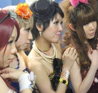 Cute factor 10, Captain: Members of The Party's (from left) bassist Jennifer, drummer Nancy, guitarist Betty and 'angel' Karen check out a boy (out of picture) backstage at Shinjuku Jam livehouse in Tokyo on Feb. 14.