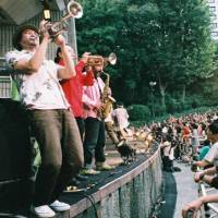 Sound spectacular: Members of the band Shibusashirazu Orchestra perform a gig in Hibiya Park that featured more than 60 performers. | JAMES HADFIELD PHOTOS