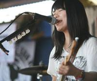 Don't mess with Texas: Chatmonchy's Eriko Hashimoto sings at the Japan Preview Show. The band was declared a hot ticket by influential music magazine Spin.   HIROSHI MAEDA PHOTO