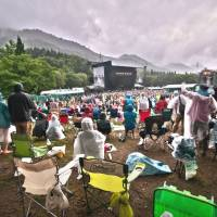 Wish you were here: Last year's edition of Fuji Rock Festival was unusually dry, but regulars will no doubt plan for the kind of drenching they received in 2011 (left) — even if they don't let it dampen their spirits. | ALEXIS WUILLAUME