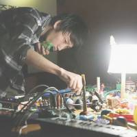 Making melodies: Experimental musican Asuna manipulates children's toys, cheap keyboards and other nonstandard instruments at a recent performance in Seoul.
