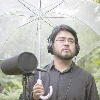Green mind: Producer Yosi Horikawa stands with a mic in Tokyo's Arisugawa Park. The artist's electronic compositions often use field recordings. | JAMES HADFIELD