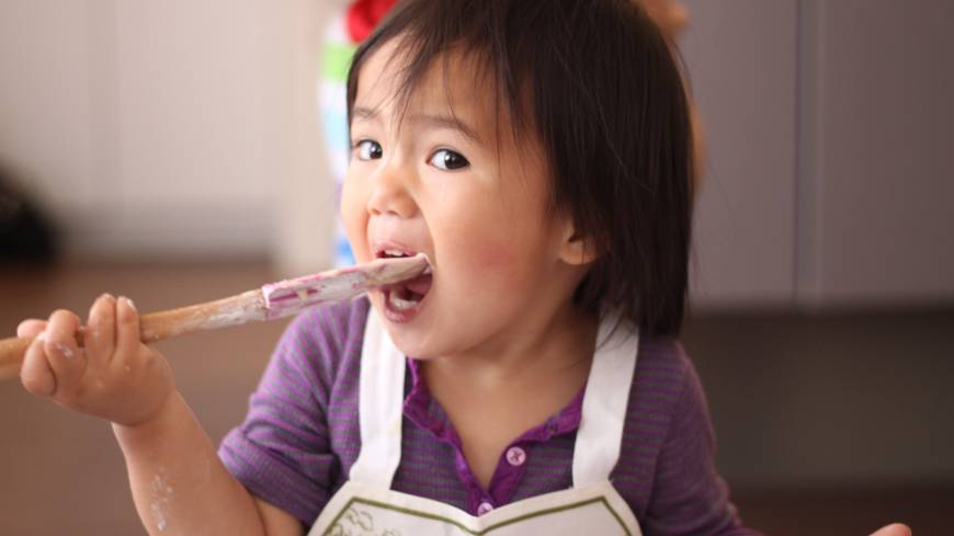 The hands-on approach: One young chef practicing quality control decides to tuck into the cake mix before it's baked.