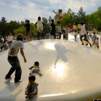 Bubble era: The Bouncing Dome area in Showa Kinen Koen, where kids of all ages can jump on rubber clouds. | JASON JENKINS