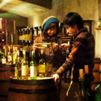 Tippling time: Visitors enjoy their tastings in Budo no Oka's wine cellar in Katsunuma.