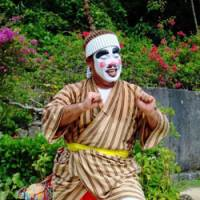 Crowd-pleaser: One of the dancers and musicians who perform at Ryukyu Mura.