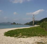 Empty Eden: A typically unpeopled arc of white sandy beach on Zamami Island.