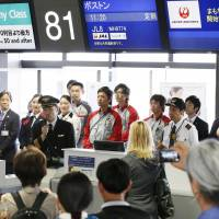All clear: The captain of a Japan Airlines flight to Boston assures passengers of the safety of Boeing's 787 Dreamliner on Saturday morning at Narita International Airport. | KYODO