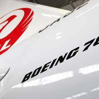 Hung up: Japan Airlines Co.'s first Boeing Co. 787 Dreamliner aircraft sits in a hangar during a media preview at Narita airport in March 2012. | BLOOMBERG