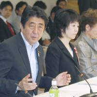 No baby steps: Prime Minister Shinzo Abe speaks to a panel meeting at the Prime Minister's Office on Wednesday. | KYODO