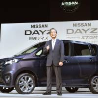 Shared platform: Nissan Motor Co. Chief Operating Officer Toshiyuki Shiga stands in front of minicar DAYZ on Thursday at a press conference in Tokyo to introduce the new car jointly developed with Mitsubishi Motors Corp. The same car will be sold by MMC under the brand name of eK-Wagon. | KYODO