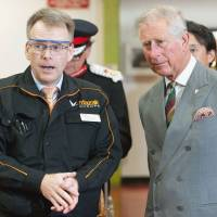 Royal visit: Britain's Prince Charles is briefed by an official during a visit to the Yamazaki Mazak factory in Worcester, central England, on Thursday. | KYODO