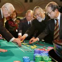 Japanese lawmakers and guests play a roulette during a trial run of casino in 2006 hosted by Japan Casino Dealers Association and Casino School in Tokyo.  | AFP-JIJI
