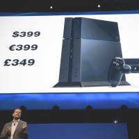 Head in the cloud: Sony Computer Entertainment President Andrew House announces the pricing for the new PlayStation 4 at the prestigious E3 2013 gaming expo in Los Angeles on Monday. | AFP-JIJI