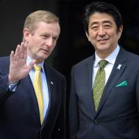 Wet the tea: Irish Prime Minister Enda Kenny welcomes his Japanese counterpart, Shinzo Abe, for a Wednesday meeting in Dublin. | AFP-JIJI