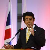 Pouring it on: Prime Minister Shinzo Abe gives a speech at the Guildhall in London on Wednesday. | AP