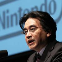 Grand plan: Nintendo Co. President Satoru Iwata attends a corporate strategy gathering in Tokyo on Jan. 31. At a shareholders' meeting Thursday, Iwata revealed plans to revive demand for the Wii U by releasing new titles developed by the firm. | BLOOMBERG