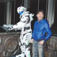 Game master: Shinji stands next to a life-size statue of Sam, the lead character from his new game 'Vanquish,' at a press event at Tokyo's Roppongi Hills. | DANIEL ROBSON PHOTO