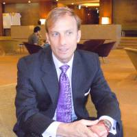 The good fight: Mark Dybul of the nongovernment organization Global Fund to Fight AIDS, Tuberculosis and Malaria is interviewed Friday in Tokyo. | TOMOHIRO OSAKI