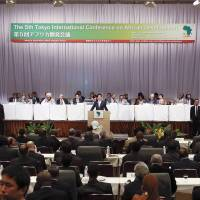 That's a wrap: Prime Minister Shinzo Abe issues the Yokohama Declaration 2013 during the Monday closing session of the Tokyo International Conference on African Development in Yokohama. | POOL