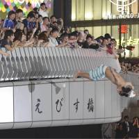 Tying one on: An excited soccer fan jumps into the Dotonbori River in Osaka's bustling Shinsaibashi district Tuesday evening after Japan qualified for the 2014 World Cup by drawing 1-1 with Australia. | KYODO