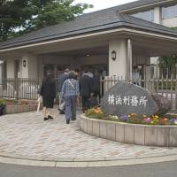 Prison tour: A group of former lay judges and their supporters take a tour of Yokohama Prison on May 30. | COURTESY OF THE LAY JUDGE COMMUNITY CLUB