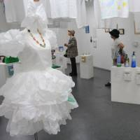 Afterlife: Visitors take a look at artworks made from recycled commodities at kimura ASK? art gallery in Chuo Ward, Tokyo, on Wednesday. | KYODO