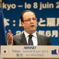 Brothers in arms: French President Francois Hollande delivers a speech at a gathering in Tokyo on Saturday. | AFP-JIJI