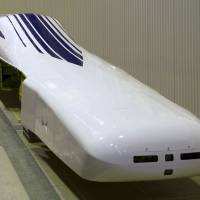 Train training: JR Tokai's L0 series maglev train, seen in Tsuru, Yamanashi Prefecture, last November, is expected to make the trip from Tokyo to Nagoya in about 40 minutes once a line is completed and commercial operations commence. | KYODO