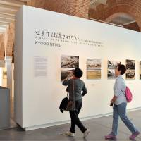 Japanese media open photo exhibit charting Tohoku's disaster recovery