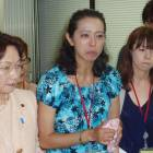 Speaking out: Mika Matsufuji (center), who represents a parents