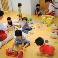 While moms work: Children of Shiseido Co. employees play Friday in the Kangaroom day care facility in its head office in Minato Ward, Tokyo. | SATOKO KAWASAKI