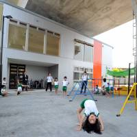 Bypass education: Children learn gymnastics at Byobugaura Harukaze Nursery, located directly under a highway bypass in Yokohama's Isogo district, on June 4. The day care center is one of 69 new facilities that opened in Yokohama in April. | YOSHIAKI MIURA