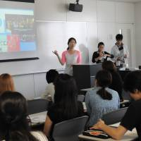 Going global: Students give a presentation in English during a class at  Waseda University in Tokyo on June 3. | SATOKO KAWASAKI