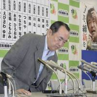 Under fire: Takeo Hiranuma, deputy leader of Nippon Ishin no Kai (Japan Restoration Party), attends a news conference in Tokyo on Sunday evening. | KYODO