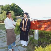 Seeking purpose: Chiaki Matsushima, a priest at Shogonji, and her husband, Tadashi, stand in front of their home-made jam store in Suo-Oshima, Yamaguchi Prefecture, in May. | KYODO