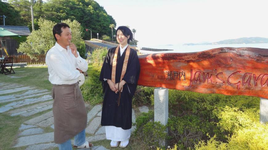 Seeking purpose: Chiaki Matsushima, a priest at Shogonji, and her husband, Tadashi, stand in front of their home-made jam store in Suo-Oshima, Yamaguchi Prefecture, in May.