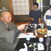 Taimei Ohara (left), deputy chief priest at Saikoji, and members of his group discuss ways to revive the lackluster local Torinoichi festival at his temple in Toyohashi, Aichi Prefecture, the same month. | KYODO