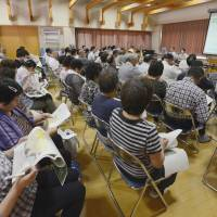 Trying to get it right: Residents of Tamura, Fukushima Prefecture, attend a meeting on decontamination efforts hosted by the central government Sunday. | KYODO