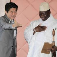 Making new friends: Prime Minister Shinzo Abe meets Gambian President Yahya Jammeh during a bilateral meeting held on the sidelines of the Tokyo International Conference on African Development in Yokohama on Sunday.  | AP