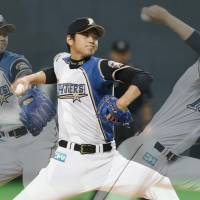 Here it comes: Fighters rookie Shohei Otani, seen firing a pitch at Sapporo Dome, strikes out four batters in his first career victory on Saturday. Hokkaido Nippon Ham defeated the Chunichi Dragons 7-3. | KYODO