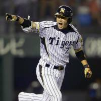 Goodbye: Hanshin's Tsuyoshi Nishioka hits a sayonara single against the Lions on Wednesday. The Tigers won 3-2. | KYODO