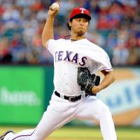 Big arsenal: Yu Darvish has earned rave reviews for his variety of pitches during his short time in the major leagues.   AP
