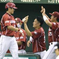 Masahiro Tanaka high-fives Toshiya Nakashima during the Rakuten Eagles' 5-3  win over the Yomiuri Giants at Tokyo Dome on Sunday.  | KYODO