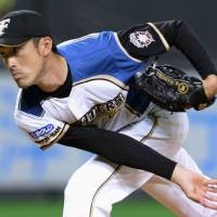 Fighting fit: Hokkaido Nippon Ham's Hiroshi Kisanuki pitches during the Fighters' 3-0 interleague win over the Tigers on Thursday. | KYODO