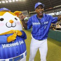 Fun and games: BayStars slugger Nyjer Morgan hangs out with team mascot DB.Starman after Saturday's game in Tokorozawa, Saitama Prefecture. Morgan had three hits, including a three-run home run, in Yokohama's 7-2 victory over the Seibu Lions. | KYODO