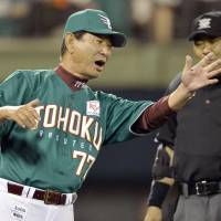 Frustrating night: Eagles manager Senichi Hoshino is not happy with a call against his team during the sixth inning of Friday's Pacific League game in Koriyama, Fukushima Prefecture. The Fukuoka Softbank Hawks beat Tohoku Rakuten 13-2. | KYODO