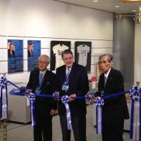 Come and see it: NPB commissioner Ryozo Kato and former Los Angeles Dodgers owner Peter O'Malley cut the ribbon Saturday at the opening of an exhibition on the O'Malley family's long relationship with Japanese baseball. | JASON COSKREY