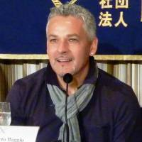 Back in the spotlight: Retired Italian soccer star Roberto Baggio speaks at the Foreign Correspondents' Club of Japan on Saturday. | KYODO
