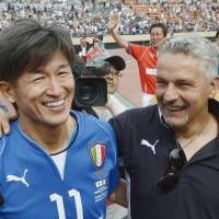 Soccer superstars Kazuyoshi Miura and Roberto Baggio share a laugh after an exhibition game celebrating J. League's 20th anniversary.  | KYODO
